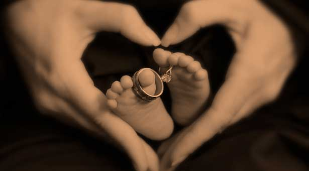 Heart surrounding baby feet