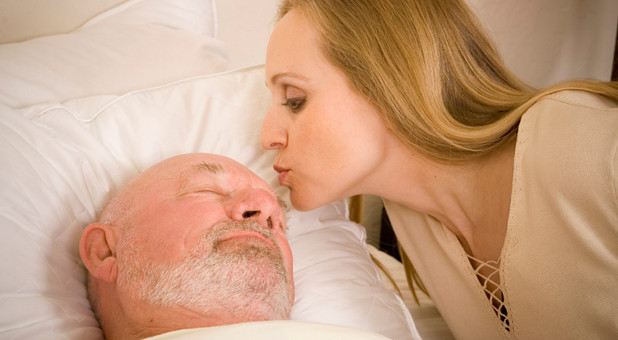 woman kisses man in hospital