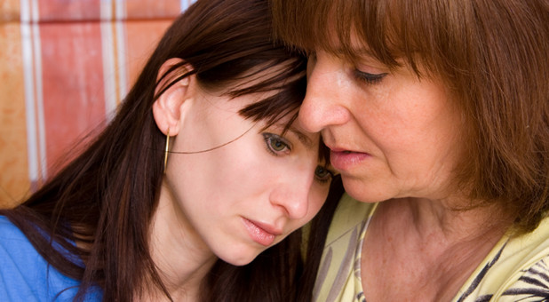 older woman showing compassion to younger woman