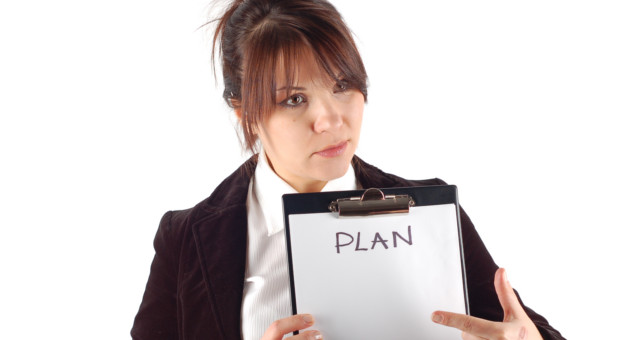 woman holding up plan