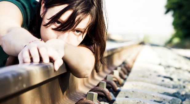 woman on railroad tracks