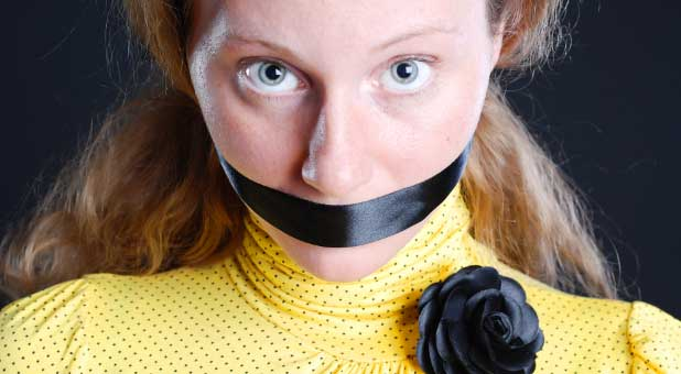 woman muzzled by tape