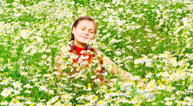 woman-joyful-flower-field