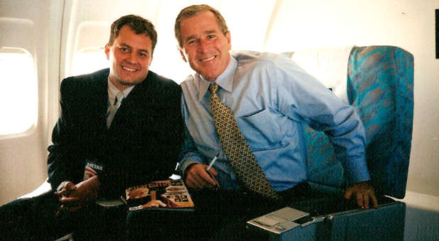 Former Charisma editor Lee Grady (l) with presidential candidate George W. Bush in August 2000.