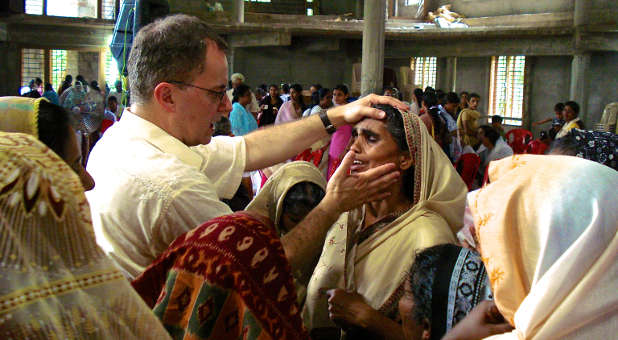 Lee Grady, founder of The Mordecai Project, ministers a group of women in India.